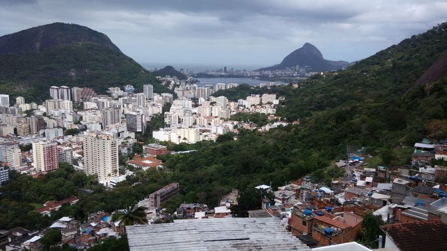 The cityscape view from slum Brazil City Cityscape Rio De Janeiro Architecture Building Exterior Built Structure Crowded Favela Favelabrazil High Angle View Mountain Outdoors Poverty Gap Residential Building Sugarloaf Mountain
