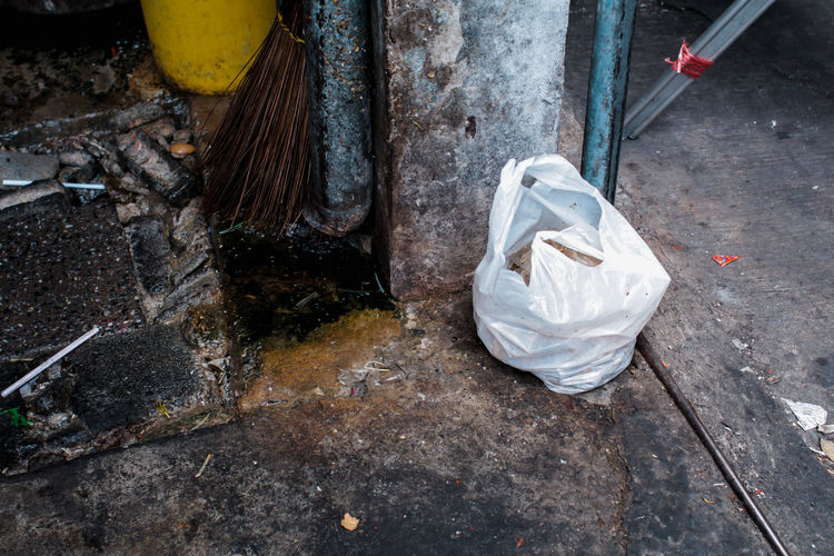 High angle view of garbage on wet street