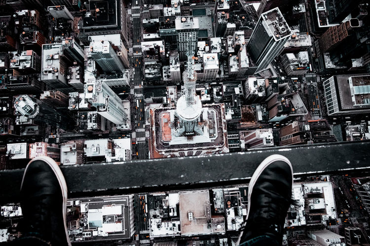 Shoes over cityscape
