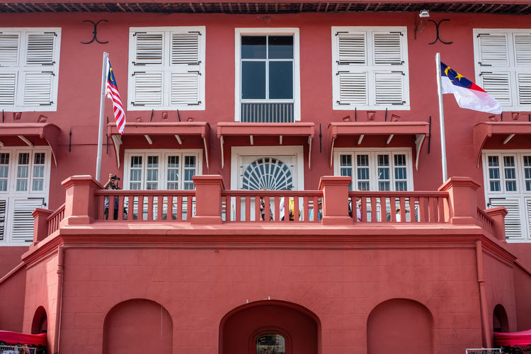 Malacca Building Exterior Built Structure Architecture Window Red Building No People Day Low Angle View Residential District City Outdoors Full Frame Flag Balcony Arch Backgrounds Pattern Pink Color Glass - Material