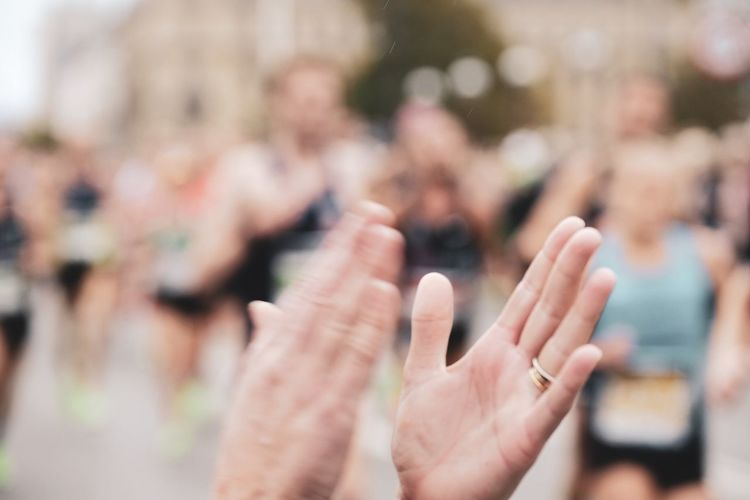 Cropped image of person clapping hands outdoors