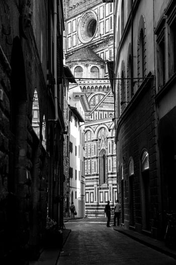 .contrast. Architecture Built Structure Building Exterior Place Of Worship City Outdoors Duomo Di Firenze Firenze Florence Italy Florence Bella Italia Architecture_collection Italia Italy Black & White Black And White Blackandwhite Small Street Narrow Narrow Street Cathedral People Street Photography Streetphotography Travel