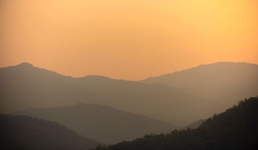 mountain sunset landscape scenic view Scenic View Mountain Scenics - Nature Beauty In Nature Tranquility Tranquil Scene Mountain Range Tree Sky Non-urban Scene Sunset Landscape Nature Fog Orange Color Forest Outdoors Plant
