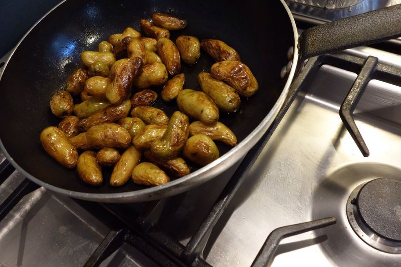 Close-Up Of Potatoes Frying In Pan