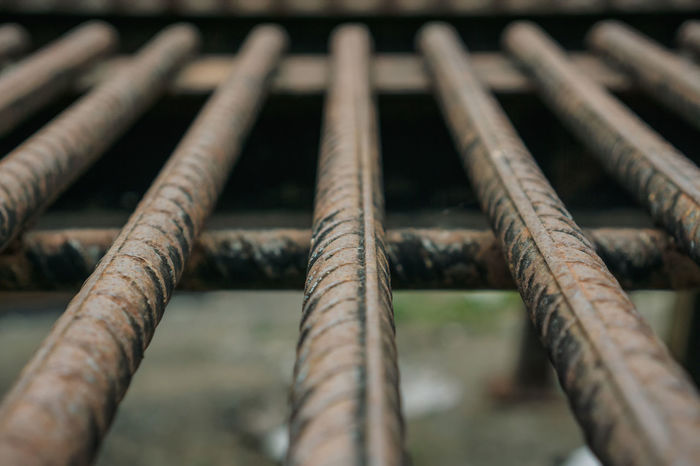 Selective focus of rusted reinforcing steel bar Rebar Close-up Day Focus On Foreground Industry Low Angle View Metal Nature No People Old Outdoors Pattern Pipe - Tube Reinforcement Bar Rod Rusty Selective Focus Side By Side Steel Bar Weathered