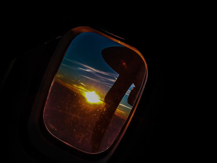 Looking through the flying Glass. Black Background No People Close-up Night Airplaneview Airplane Wing Airplane Window AirPlane ✈ Airplane Window View Airplane Collection Sunsets Sunset And Clouds  Sunset_captures Sunset Collection Airplane Propeller Propeller Blades
