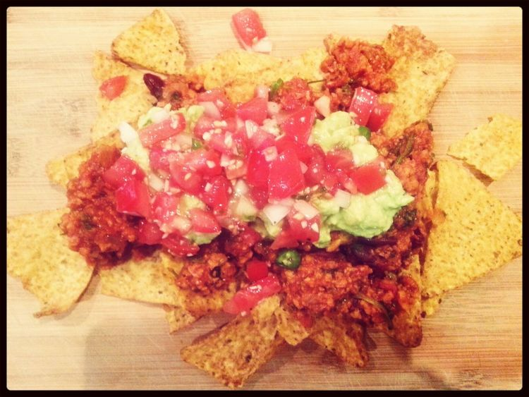 Soy Mince Nachos with fresh guacamole and spicy salsa.