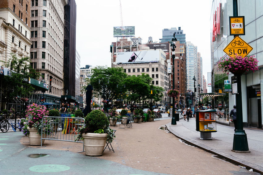 Herald Square in NYC Broadway NY NYC Architecture Building Building Exterior Built Structure City City Life City Street Day Group Of People Herald Square Incidental People Nature Outdoors Plant Potted Plant Real People Road Sign Sky Street Transportation Tree