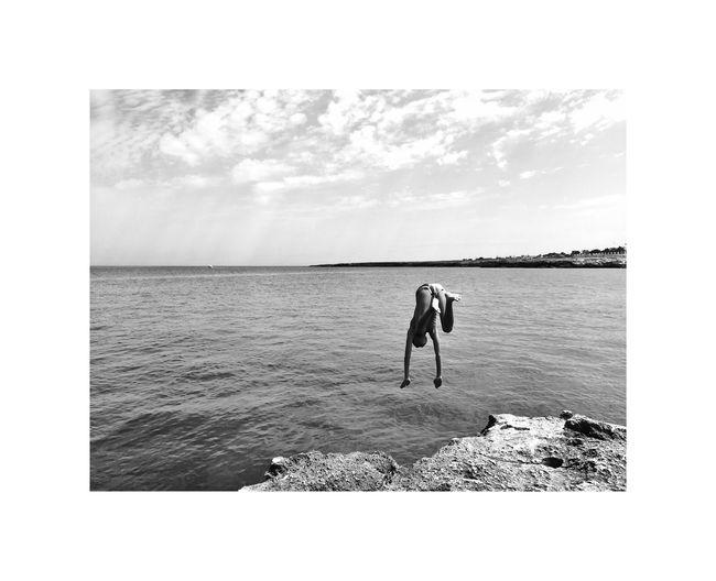 Man on sea shore against sky