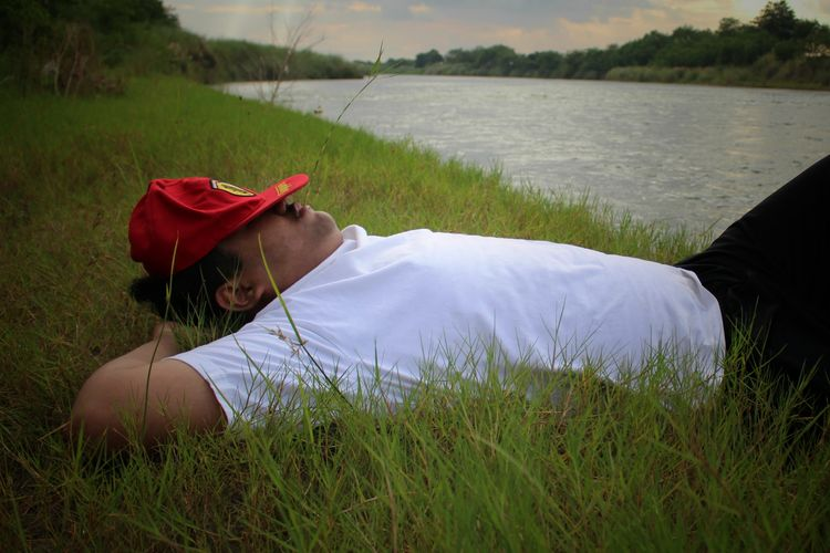 Agno River, Philippines Feeling Relax Grass One Person Lake Water Adult People Nature Outdoors Sleeping In The Grass Sleeping In The Lake EyeEmNewHere