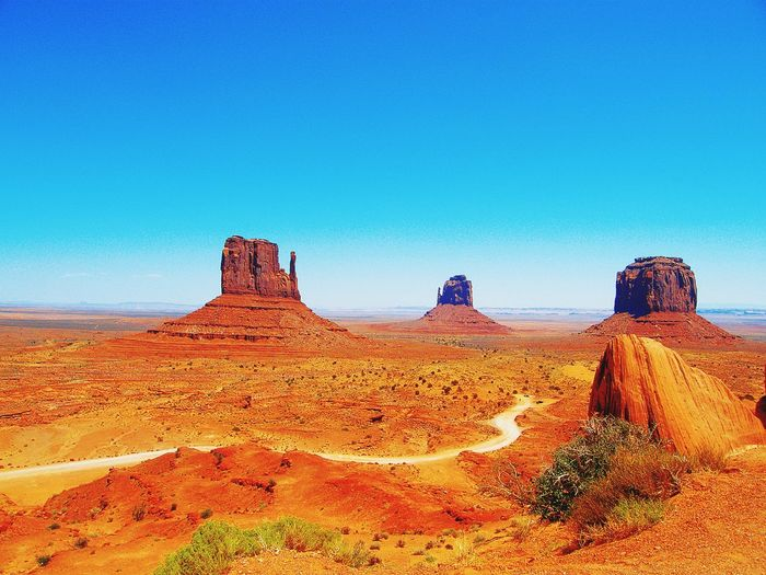 Rock formation at monument valley against clear blue sky