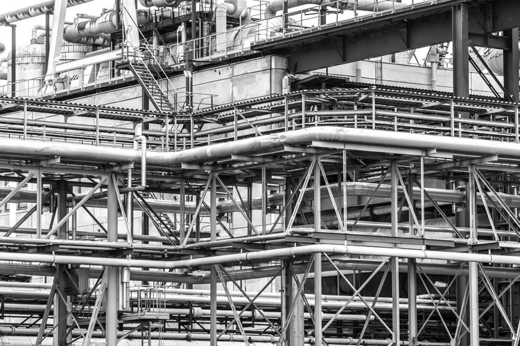 Black And White Urban Factory Business Finance And Industry Environmental Issues Industry Architecture Pipe - Tube Pipeline Metal Built Structure Building Exterior Industrial Building  Fuel And Power Generation No People Complexity Connection Day Technology Low Angle View Machinery Outdoors Pipe Construction Industry Industrial Equipment Steel Alloy Metal Industry