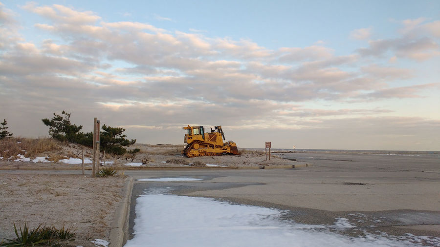 Buldozer Lonely Winter Beach Cloud - Sky Horizon Over Water No People Outdoors Sea Vehicle Water