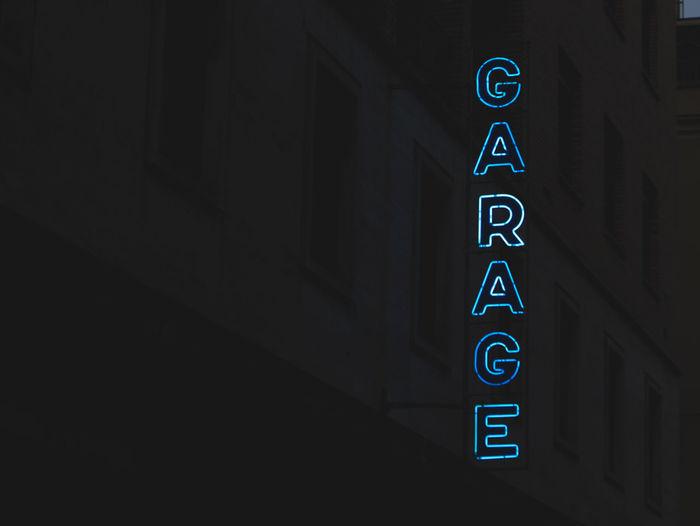 Illuminated garage text against building