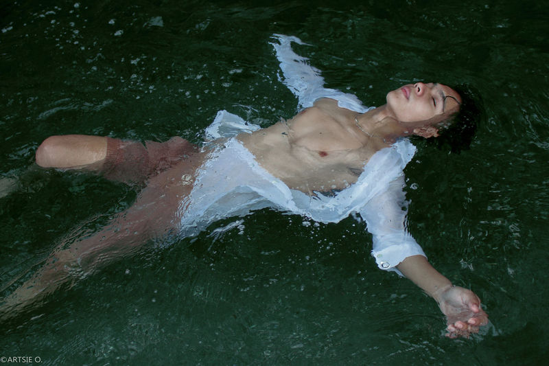 High angle view of young man swimming in lake