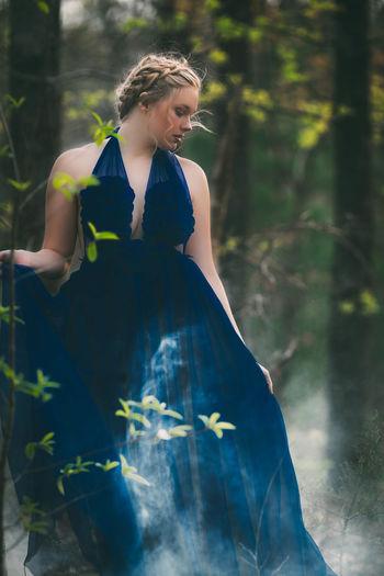 Young woman wearing blue dress
