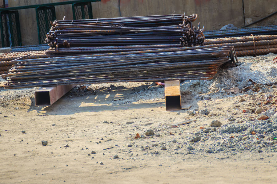 Bent deformed steel bars ready for reinforced concrete work Reinforced Concrete Reinforcements Reinforcing Bar Absence Architecture Beach Bench Building Exterior Built Structure Construction Industry Construction Site Day Field Industry Land Metal Nature No People Old Outdoors Reinforced Reinforced Steel Reinforcement Reinforcement Bar Reinforcement Conc Reinforcement Steel Reinforcing Steel Bars Sand Steel Steel Bar Steel Bars Steel Rod Sunlight Wood - Material