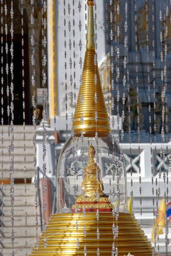 Beaded curtains hanging around stupa at wat phitchaya yatikaram worawiharn
