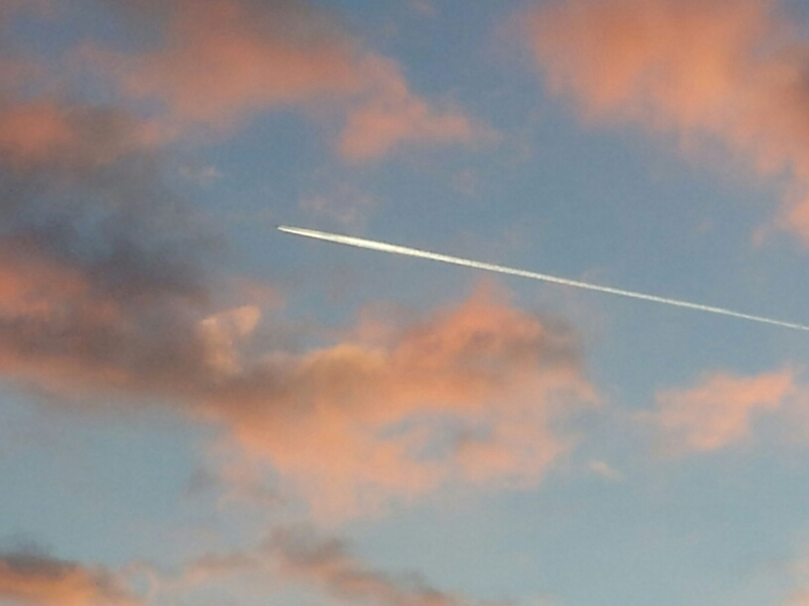sky, airplane, cloud - sky, low angle view, air vehicle, flying, transportation, cloudy, scenics, sunset, cloud, beauty in nature, nature, vapor trail, mode of transport, cloudscape, mid-air, sky only, tranquility, aircraft wing