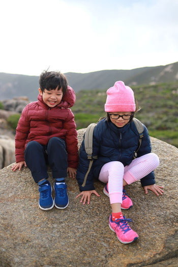 Sibling happy moments Child Childhood Real People Full Length Girls Two People Leisure Activity Lifestyles Family Front View Sky Sitting Togetherness Emotion Pink Color Land Happiness Sister Innocence Positive Emotion Warm Clothing Sibling Love Happy Moments Traveling Outdoor