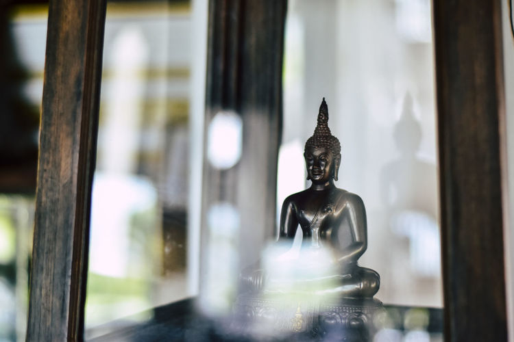 Sculpture of buddha statue outside building