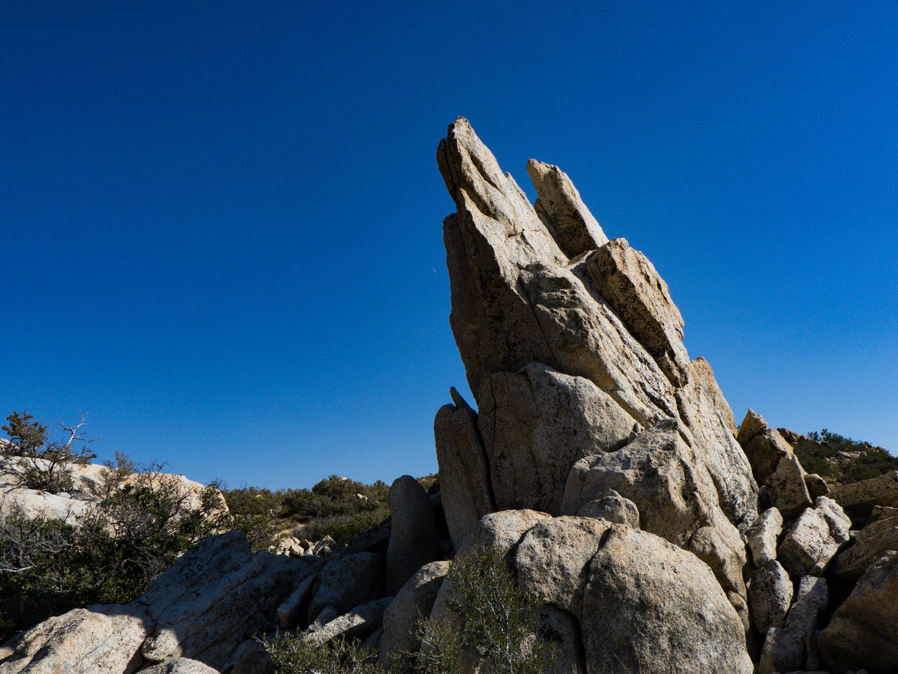 rock - object, blue, rock formation, clear sky, geology, copy space, nature, day, low angle view, outdoors, no people, physical geography, cliff, sunlight, tranquility, beauty in nature, scenics, sky