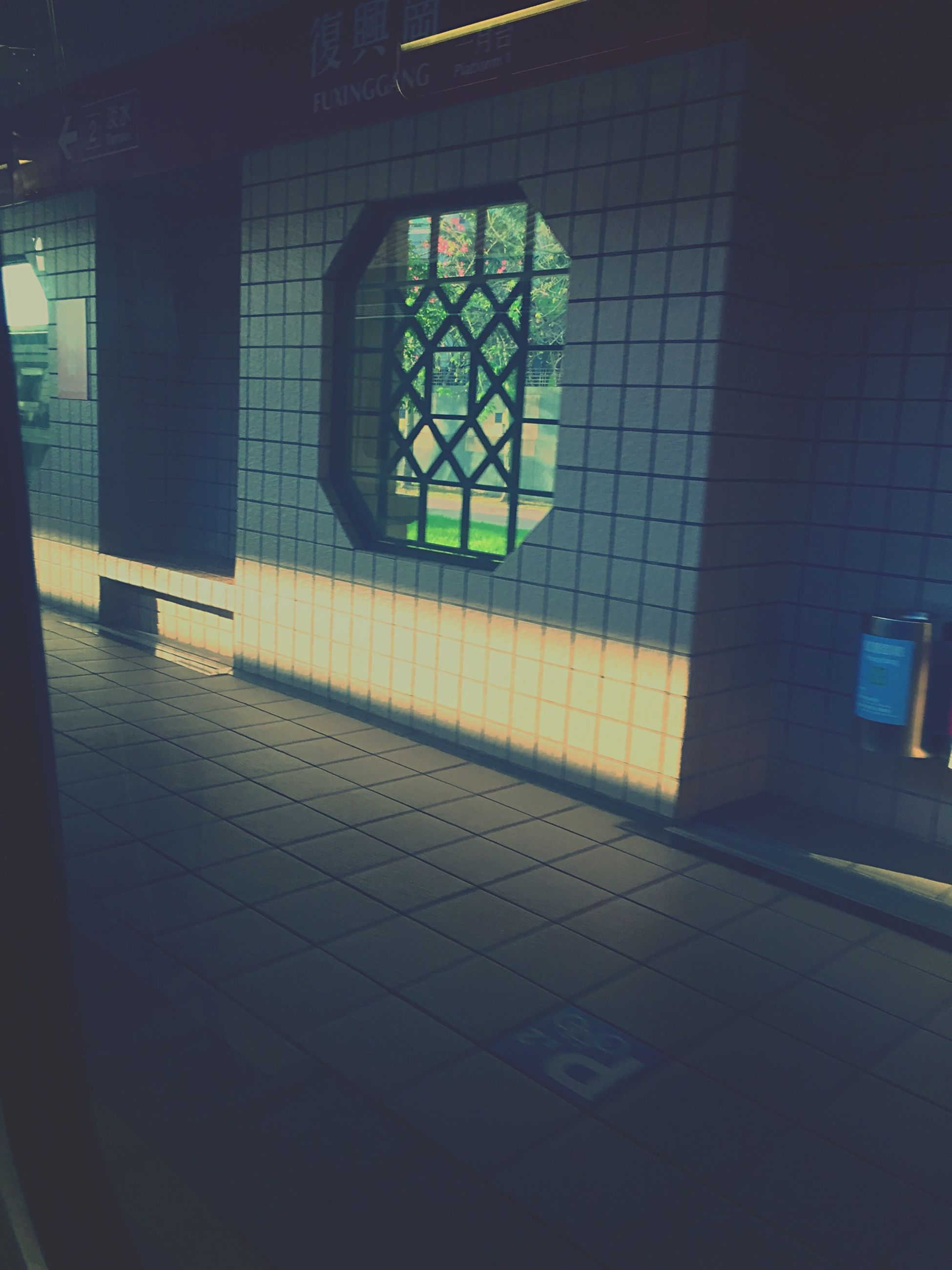 indoors, window, architecture, built structure, glass - material, illuminated, shadow, flooring, sunlight, tiled floor, building exterior, transparent, pattern, no people, wall - building feature, interior, building, reflection, empty, day