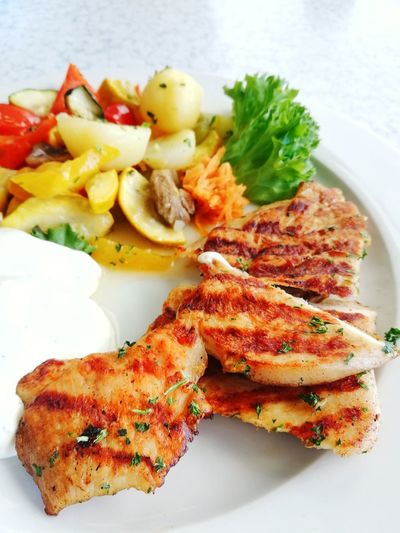 Delicious grilled chicken with fresh vegetables in white plate prepared for eating Grilled Chicken Dinner Lunch Lunch Time! Delicious Tasty Gourmet Food And Drink White Background Plate Meal mealtime Lunch Time! Dinner Time Food Enjoying Life Vegetables Healthy Eating Appetizer Herb Gourmet Vegetable Plate Close-up Food And Drink Serving Dish Served Food State Food Styling Main Course