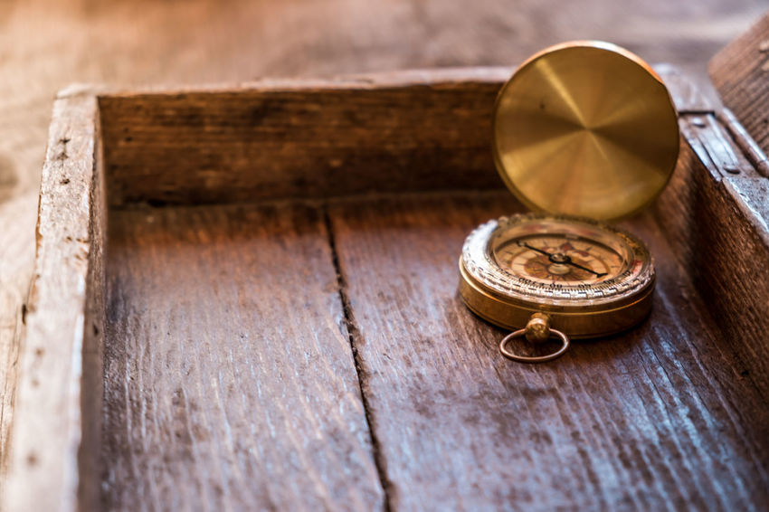 Compass on old Wooden Box Adventure Ancient Antique Close-up Compass Conceptual Photography  Direction Discovery Focus On Foreground Geography Geography Trip Grunge Magnetic Map No People Obsolete Old Orientation Retro Selective Focus Snail Travel Vintage Wood - Material Wooden