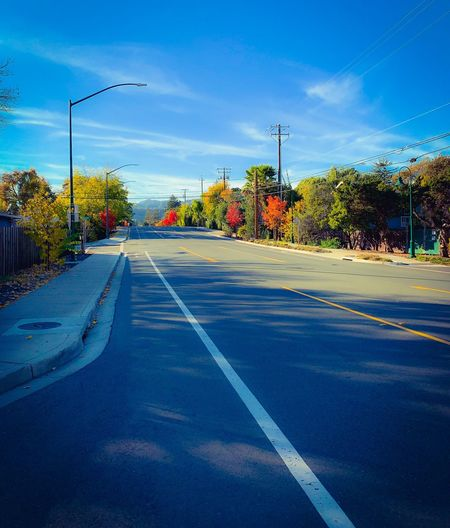 """Autumn Road"" Autumn 2018 on a Main Street In The San Francisco East Bay Area, rarely free from traffic, crisp and clear with beautiful Autumn colors lining its route. Roads Autumn colors Fall Colors City Street Road Sky Transportation Nature Direction The Way Forward Cloud - Sky No People Diminishing Perspective"