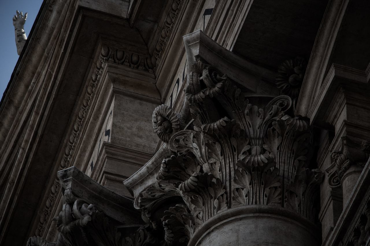 architecture, art and craft, history, representation, built structure, sculpture, low angle view, the past, human representation, craft, statue, creativity, male likeness, no people, building exterior, carving - craft product, architectural column, building, day, place of worship, government, ornate, carving