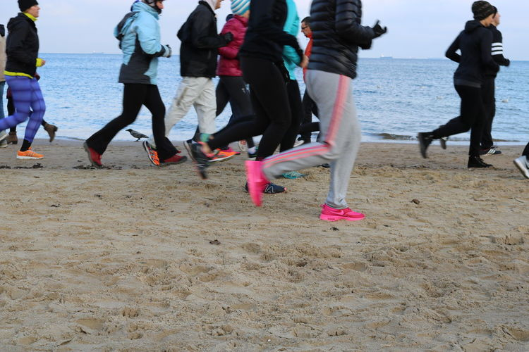 Adult Adults Only Athlete Beach Competitive Sport Day Human Body Part Human Leg Large Group Of People Lifestyles Low Section Marathon Men Motion Outdoors People Runners Running Sea Sea And Sand Self Improvement Speed Sport Track And Field Athlete Young Adult