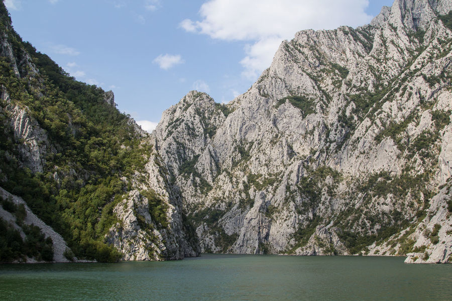 The ferry ride over the lake Koman should really be on your list when you visit Albania, as you pass a wild stunning landscape and probably will meet interesting people, locals and travellers. More on my Blog: mr-mojo-risin.net/2017/09/29/exploring-albania/ Albania Albanian Beauty In Nature Cliff Day Environment Formation Koman Land Mountain Nature No People Outdoors Rock Rock - Object Scenery Scenics - Nature Sea Sky Tranquility Tree Water Waterfront