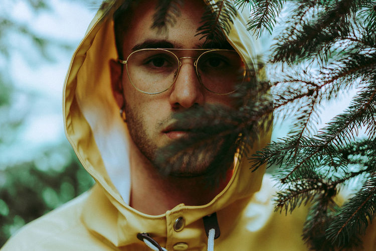 Portrait Of Young Man In Eyeglasses And Hood