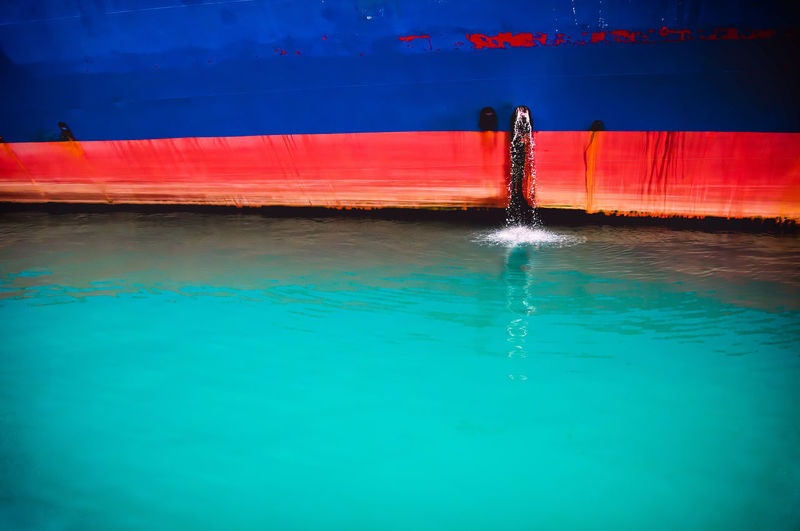 Blue Greece Illuminated Minimal Nature Night No People Outdoors Piraeus Portrait Red Rippled Ship Stripes Everywhere Water
