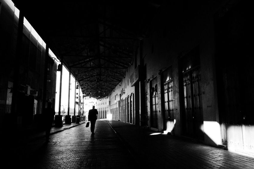 Welcome To Black EyeEm Eyeem Philippines Black & White Monochrome Visual Exercise Shoot Your Vision Street Photography Street Is Life One Person Full Length Outdoors Sidewalk Framed City Memories EyeEmNewHere Silhouette Men Adult Person Long Goodbye