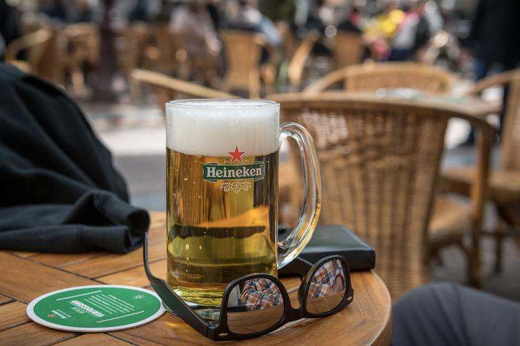 Beer outside Table Food And Drink Communication Drink Focus On Foreground Cup Close-up Mug Still Life Cafe Restaurant Beer Heineken Sunglasses Beer Glass