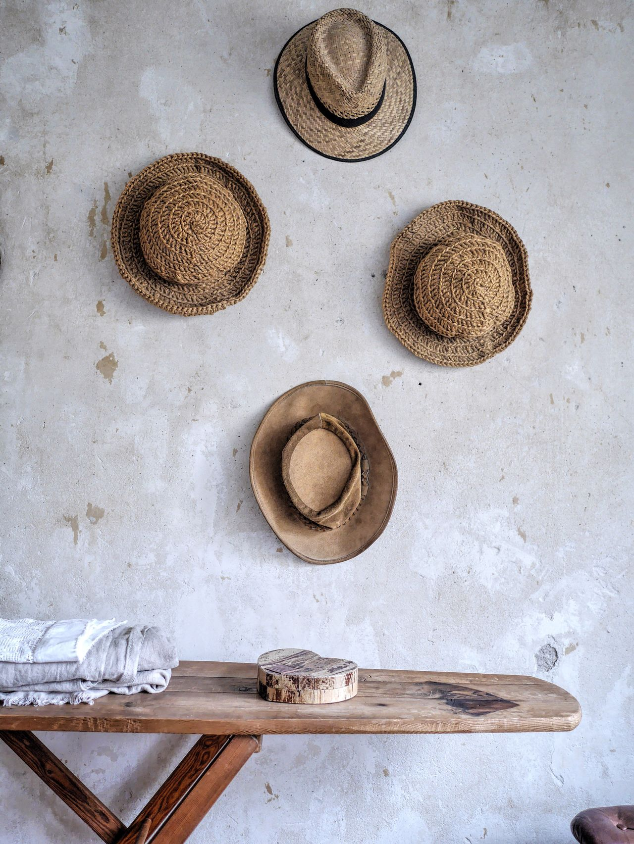 Table against wall with hats at home