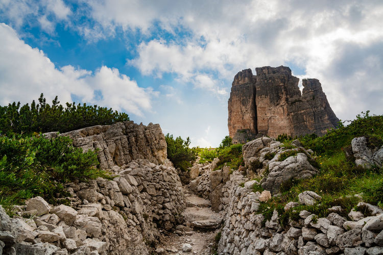 First world war trench near the dolomitic mountain group cinque torri against sky