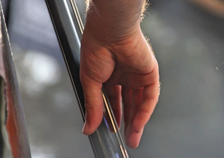 Close-up of hands holding glass