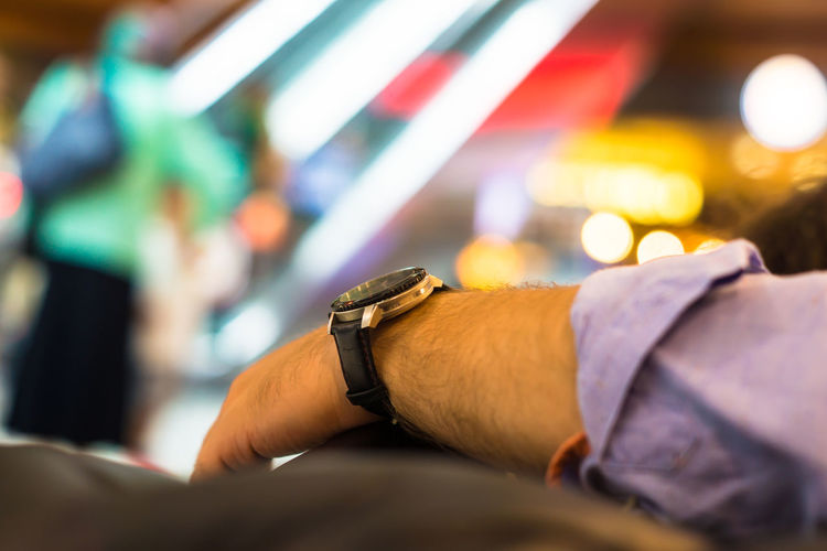 Cropped hand of man with wristwatch