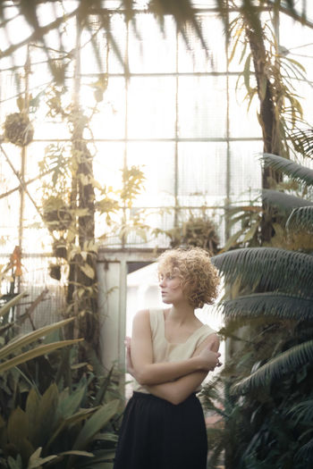 Beautiful Woman Curly Hair Day Growth Indoors  Leisure Activity Lifestyles One Person Real People Standing The Portraitist - 2017 EyeEm Awards Tree Young Adult Young Women