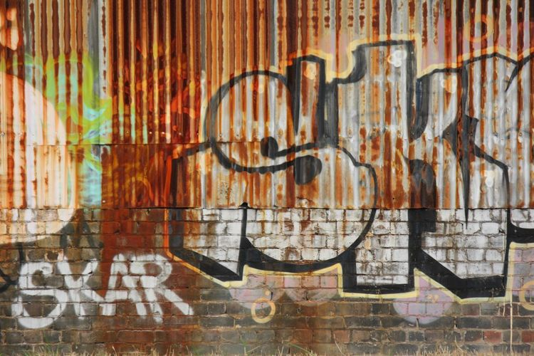 Digital composite image of graffiti on wall