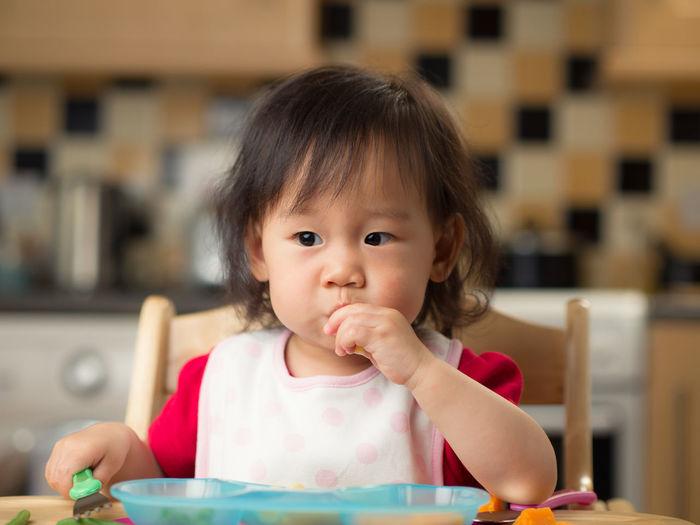 Portrait of cute girl eating