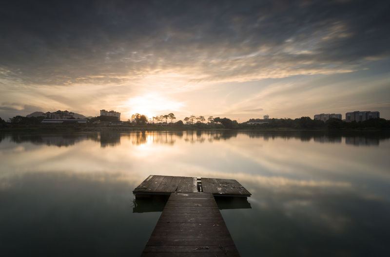A wooden pier used by local fisherman for their daily activity. Architecture Beauty In Nature Cloud - Sky Day Lake Nature No People Outdoors Pier Politics And Government Reflection Rise Rise And Shine Scenics Sky Success Summer Sunset Water Wooded Wooden
