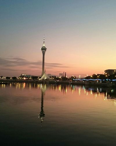 Nature's light fading into artificial lights.Creative Light And Shadow The Phoblographer Macau Tower Phone Photography Scenery Sunset