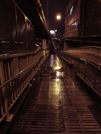 Surface Level Of Pathway Along Railings At Night
