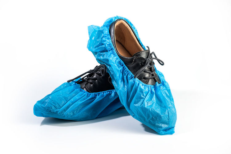 Close-up of blue shoes against white background