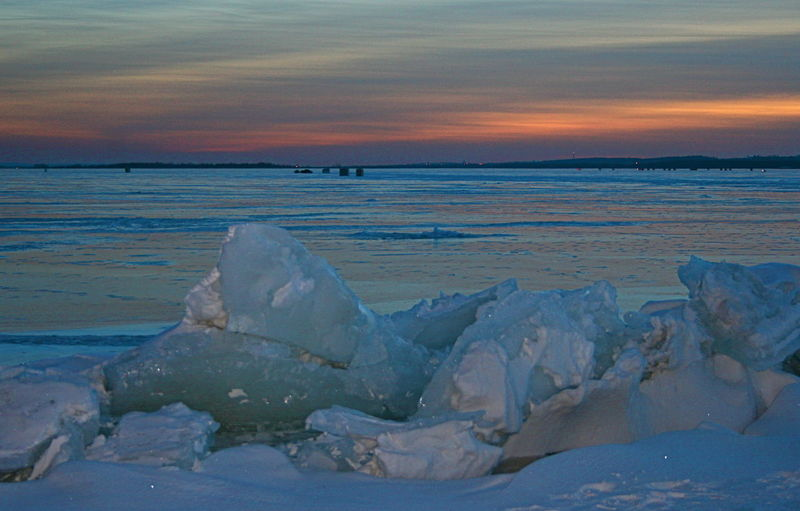 Ice pressure crack at sunset with ice fishing huts Cold Cold Temperature Horizon Over Ice Ice Fishing Huts In Background Ice Pressure Crack At Sunset Light Relections On Ice Sunset Over Frozen Lake Winter Lake Simcoe
