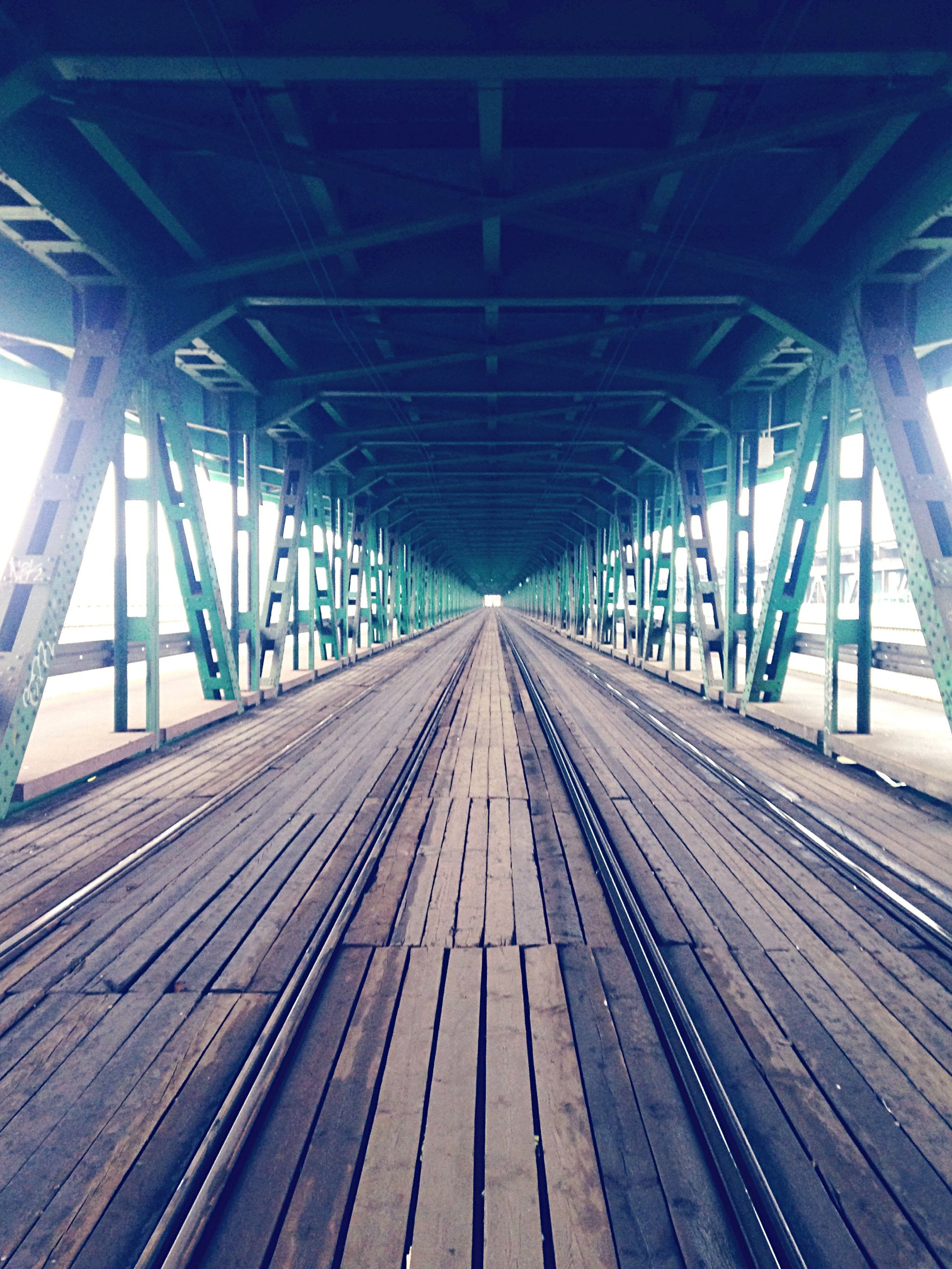 the way forward, diminishing perspective, vanishing point, transportation, railroad track, rail transportation, built structure, architecture, indoors, long, ceiling, connection, metal, empty, no people, day, surface level, wood - material, straight, bridge - man made structure